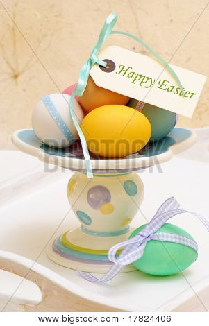 Colourful Easter eggs arrangement on wooden tray