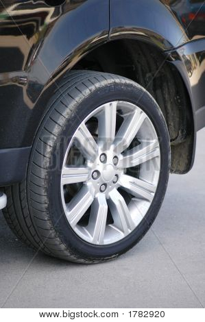 Car Tyre Of A Shiny Black Car