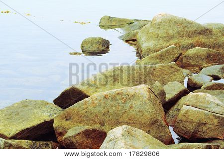 Greenish Rocks And Water