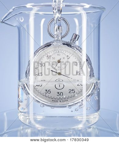 Stopwatch In A Glass With Water