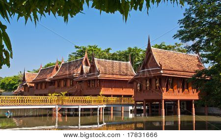 Thai Style Teak Houses In The Pond