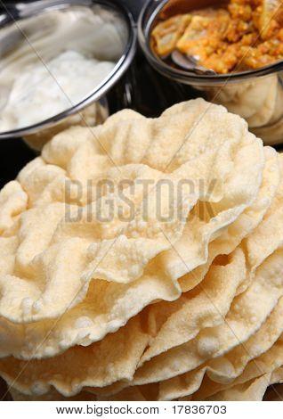 Indian poppadums with raita and mango chutney.