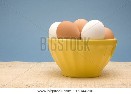 Bowl Of Fresh White And Brown Eggs