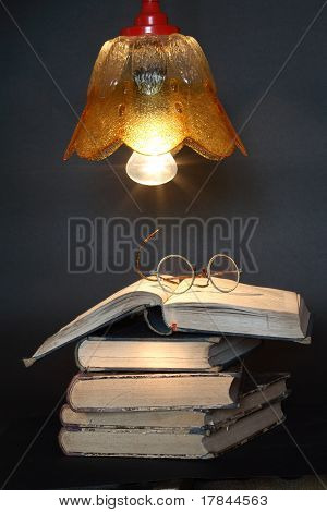 Books Under Lamp