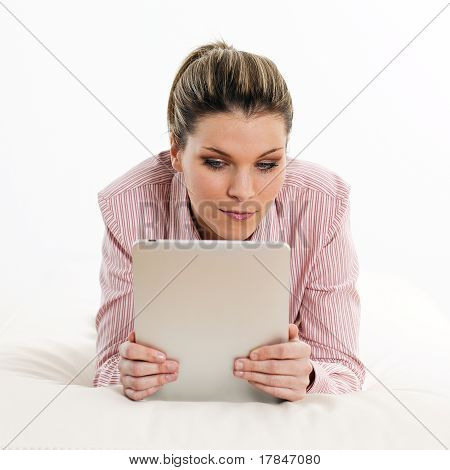 beautiful woman on sofa with notepad
