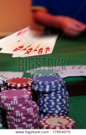 Poker Player Showing Winning Royal Flush
