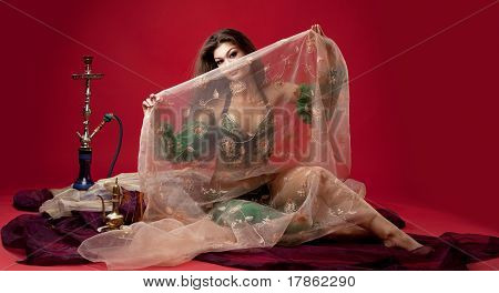 beauty young woman with hookah on veil