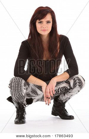 Young urban girl in black boots