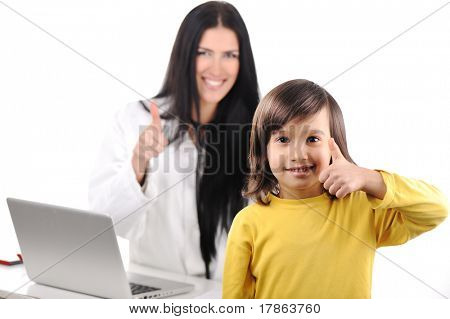 Young female doctor examining little cute happy child with thumb up, good experience at hospital
