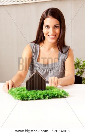 A design professional showing a green living concept - sharp focus on house