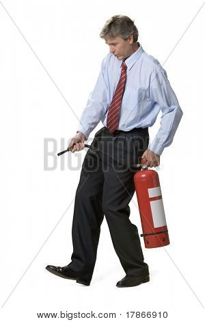 Businessman with fire extinguisher over isolated white background