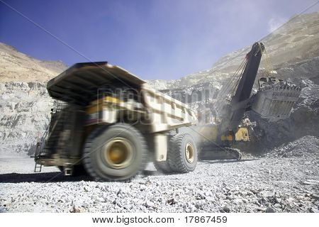 Copper mining truck loaded with raw material in Chile