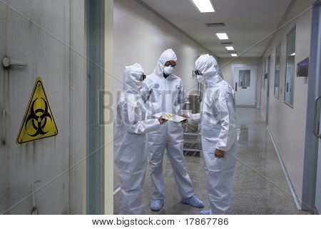 Bio hazard scientists receiving a confidential document