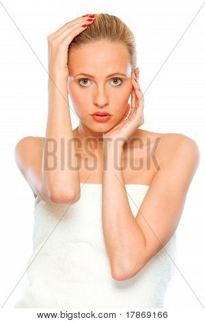 Portrait of fresh beautiful young woman with hands near face isolated on white