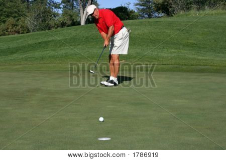 Man About To Make Putt, Focus On Golfer