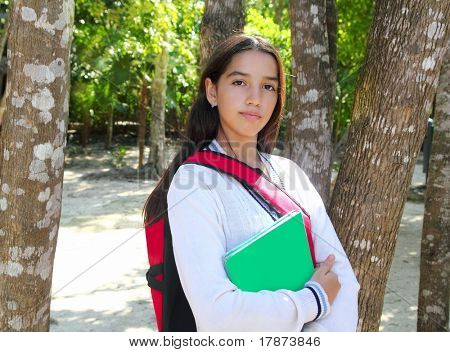 hispanic latin teenager student girl backpack in jungle park Mexico