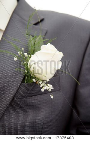 Rose In His Lapel Of His Jacket The Groom
