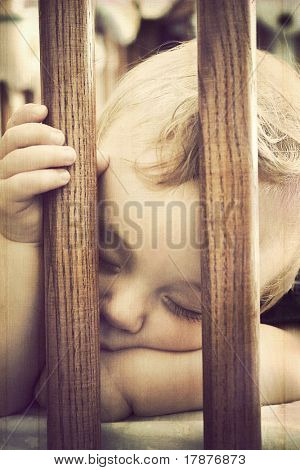 Baby sleeping in a crib, vintage grunge style