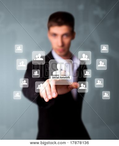 Man Pressing Social Network Icon