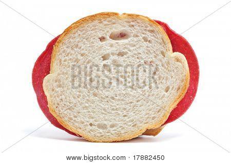 a salami sandwich on a white background