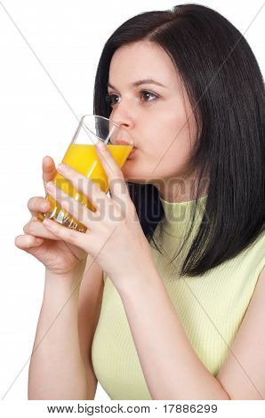 Woman with a glass of oranges juice