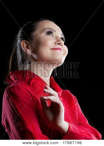 woman in red suit smile and dream