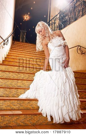 Beautiful Girl In A Wedding Dress Going Down The Stairs