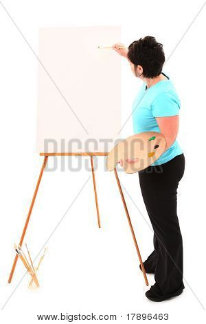 Overweight Woman At Easel Painting With Clipping Path