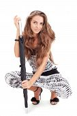 picture of harem  - Young pretty lady in harem pants posing with black umbrella on white - JPG