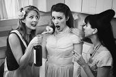 pic of peer-pressure  - Retro styled older women pressure another lady with smoking and alcohol - JPG