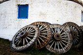 foto of yurt  - Wooden wheels outside the yurt in Inner Mongolia - JPG