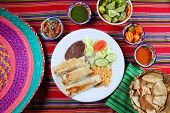 foto of poblano  - Burritos mexican rolled food rice salad and frijoles Mexico food - JPG
