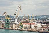 picture of shipbuilding  - Powerful shipbuilding shipyard with a pier and cranes - JPG