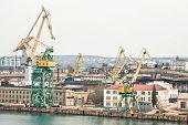 image of shipbuilding  - Powerful shipbuilding shipyard with a pier and cranes - JPG