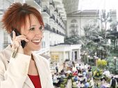 foto of opryland  - Beautiful thirty something Caucasian redhead on cellphone at the hotel - JPG