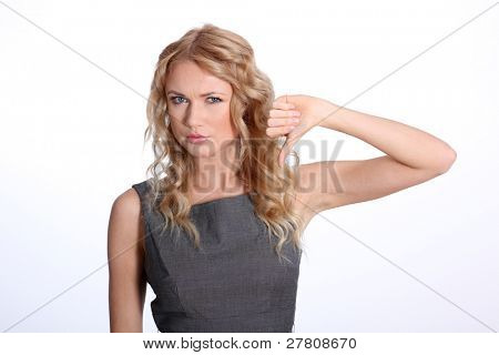 Businesswoman showing thumb down