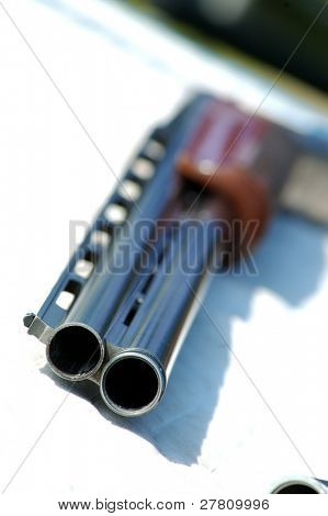close up of over under 12 gauge skeet gun