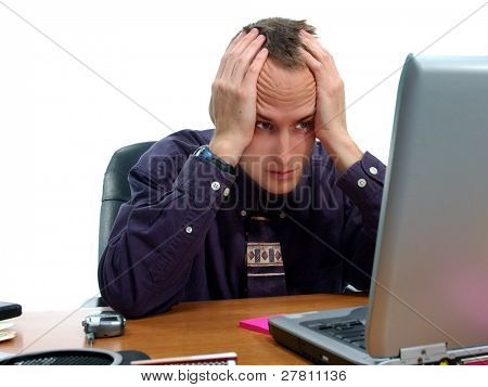 Stressed out businessman at his computer
