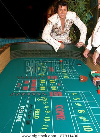 The King, Elvis Presley impersonator playing craps in Las Vegas