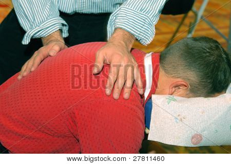 Businessman receiving a massage from a RMT at the Relaxation Station at a industry tradeshow