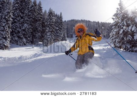 Snow Skier In Winter Forest