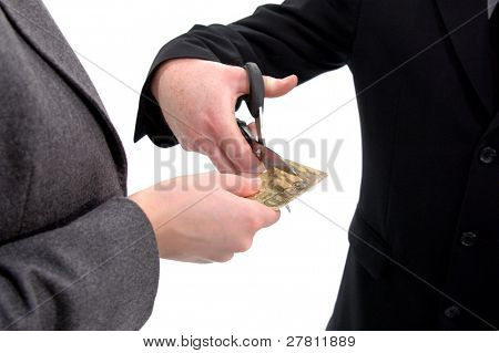 Businessman cutting a businesswoman's budget by cutting up her credit card, isolated over white