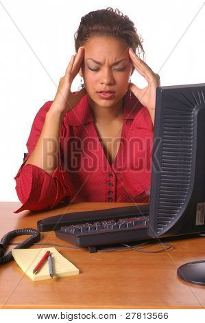 Beautiful female executive in the office with a tension headache
