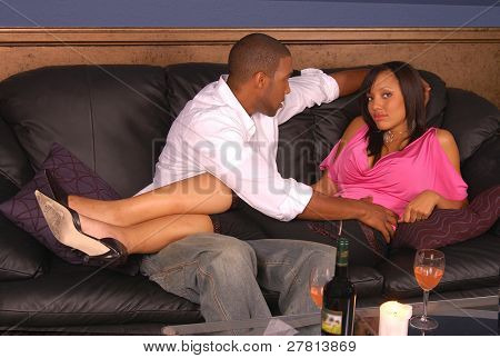 Casual Couple sharing and intimate glass of wine in the home