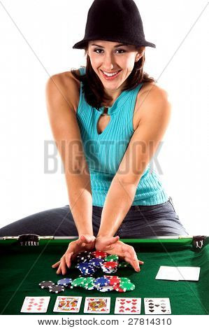 A sexy young brunette playing Texas Holdum Poker goes All In