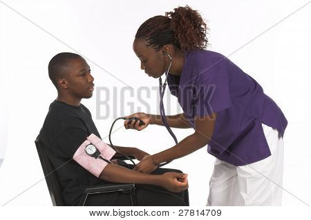 African American nurse taking the blood preasure of a male African American patient