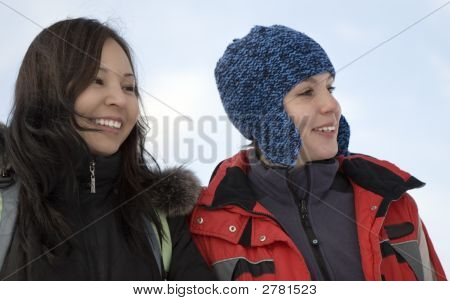 Two Girls Teens In Sport Clothes Over Blue