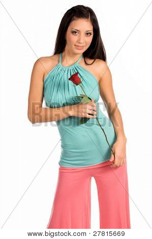 Beautiful and sexy young latina woman in  stylish casual fashions holding a single Red Rose