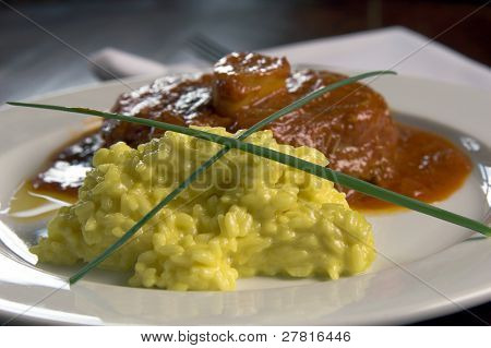 Osso Buco, veal shanks that are braised in wine with saffron risotto