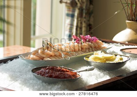 Extra large cocktail shrimp on ice at an upscale party
